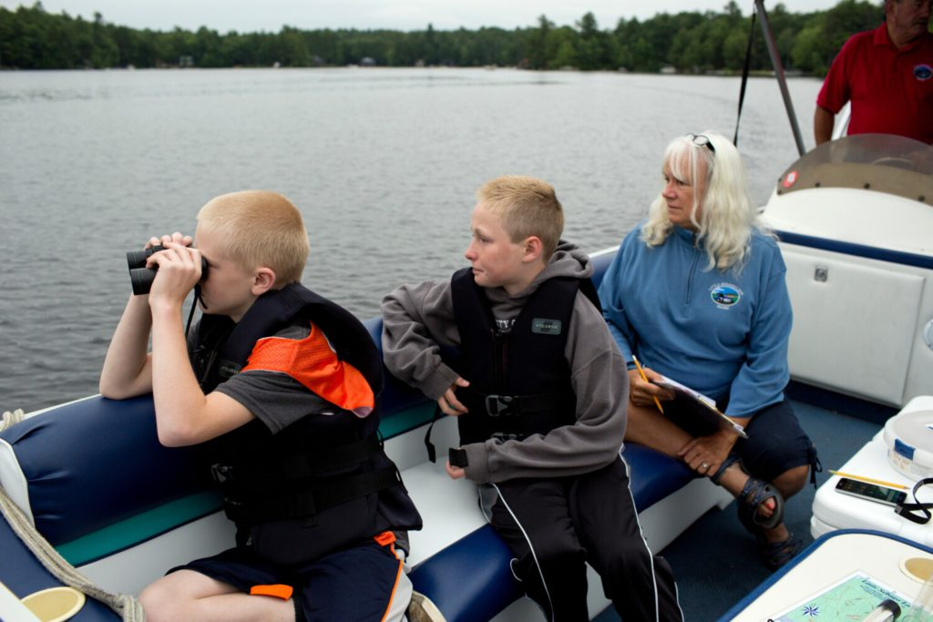 The Wilkinson family looks for loons on Little Sebago during the 2017 Loon Count. The event has been held annually since 1983, and the estimated loon population has doubled since then. Contributed / Maine Audubon